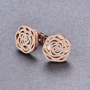 Frosted covered Camellia stud earrings.